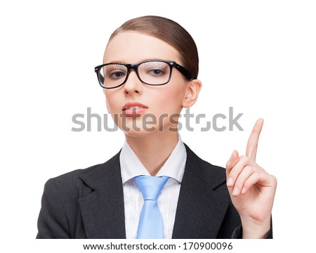 Female businessperson pointing on product - stock photo