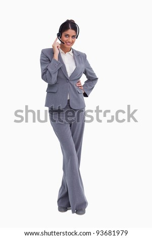 Female call center agent with crossed legs against a white background - stock photo