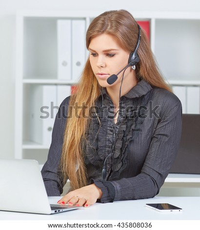 Female call center service operator at work. Portrait of pretty female consultant with headset at workplace. Effective and efficient business information, help and support concept - stock photo