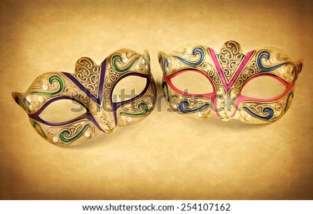 Female carnival mask on vintage background - stock photo