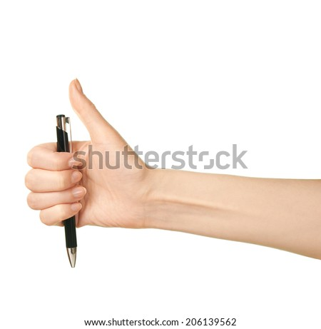 Female caucasian hand holding black pen, isolated over the white background - stock photo