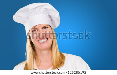 Female Chef against a blue background - stock photo