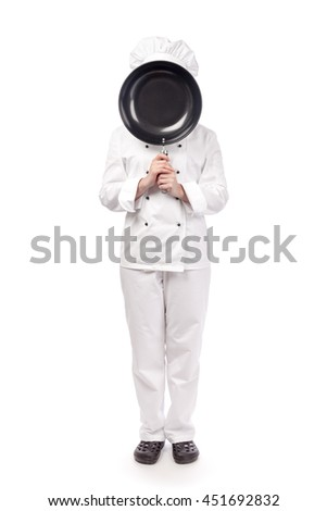 female chef, cook or baker face hidden behind wok pan isolated on white background. food, restaurant and cooking concept
