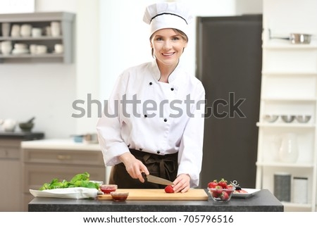 Female chef cooking in kitchen