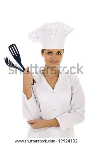Female chef holding cooking utensils - stock photo