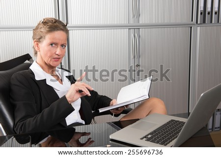 female chef in the office talking about results
