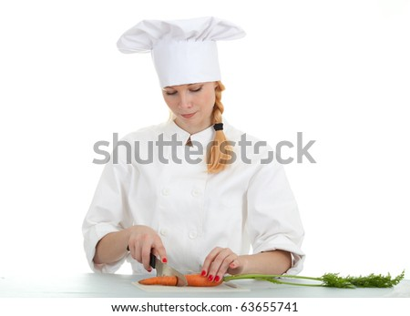 female chef in white uniform cutting carrots - stock photo