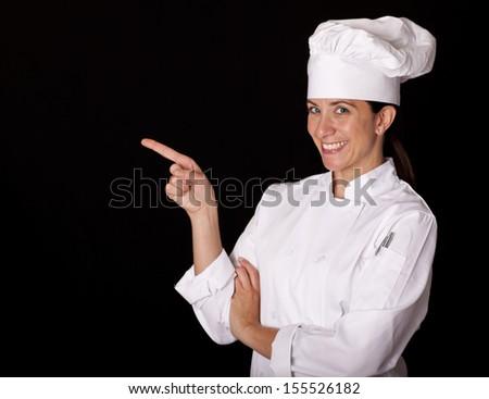 Female chef isolated on black background - stock photo