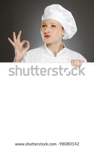 Female chef showing positive gesture with blank copy space - stock photo