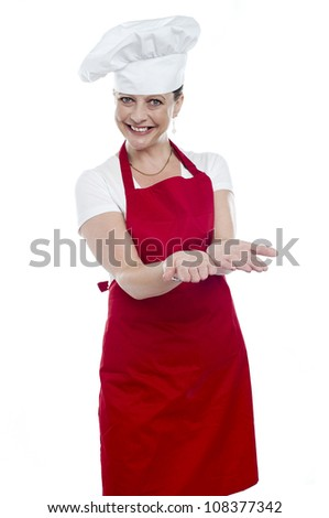 Female chef with open palms against white background