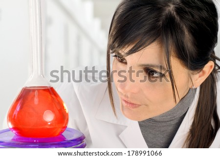 female chemist with flask at laboratory