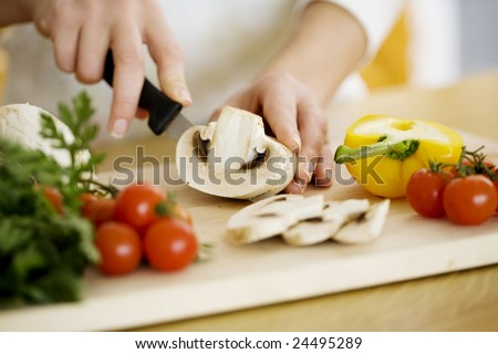 female chopping food ingredients - stock photo
