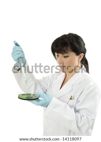 Female clinician wearing lab coat and using a fixed volume pipette.