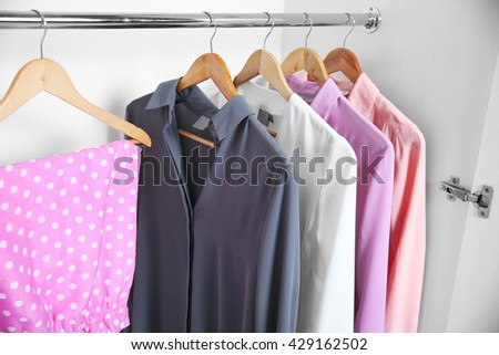 Female clothes hanging in wardrobe