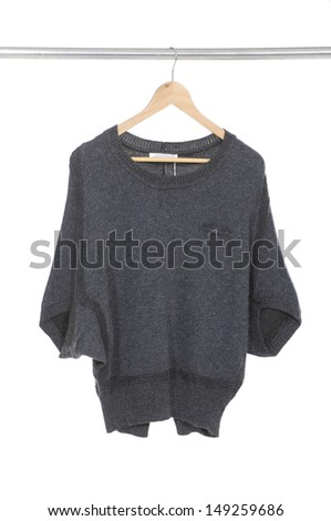 female clothes on a hanger on white  - stock photo
