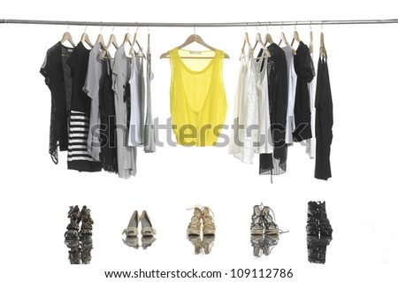 female clothes on hangers and shoes - stock photo