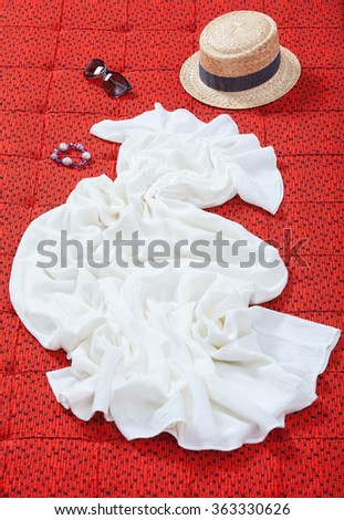 Female clothes on textile red background