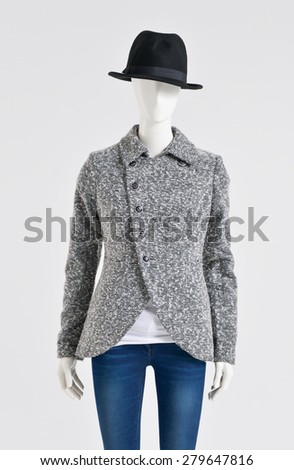 female clothing in coat with jeans with hat on mannequin  - stock photo
