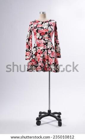 Female clothing on mannequin isolated-gray background - stock photo