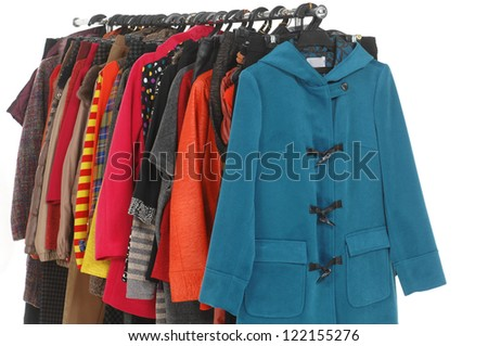 female coat clothes hanging on clothes rack - stock photo