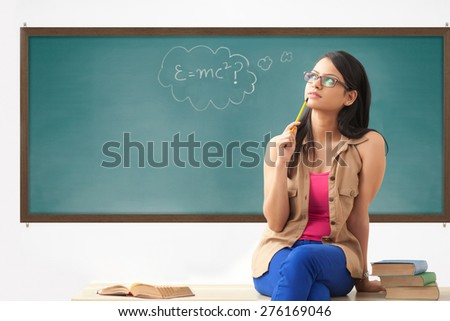 Female college student thinking - stock photo