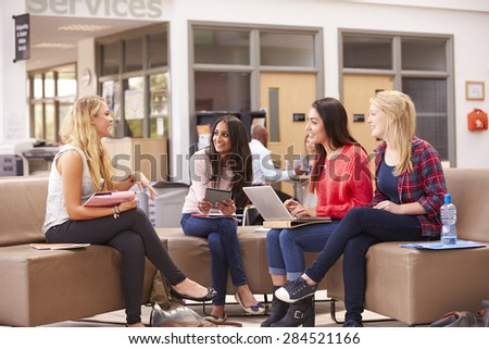 Female College Students Sitting And Talking Together - stock photo