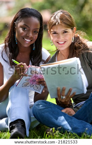 female college students smiling outdoors looking very happy