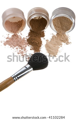 Female color cosmetics and brush for a make-up on a white background - stock photo