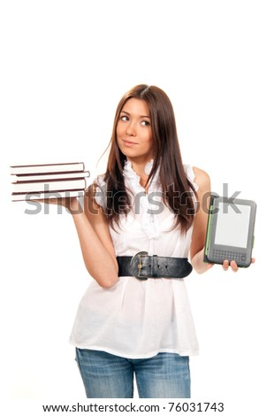 Female compare books and new wireless reading digital book Device. She holds books and ebook reader in hands like balance isolated over white background - stock photo