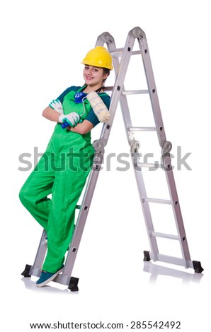 Female construction worker with toolkit and ladder - stock photo
