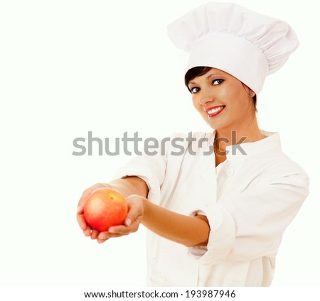 female cook in uniform with apple, white background - stock photo
