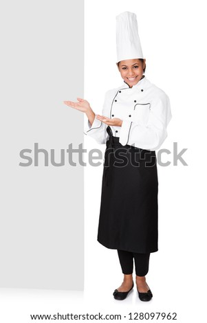 Female Cook Standing Behind The Placard. Isolated On White - stock photo