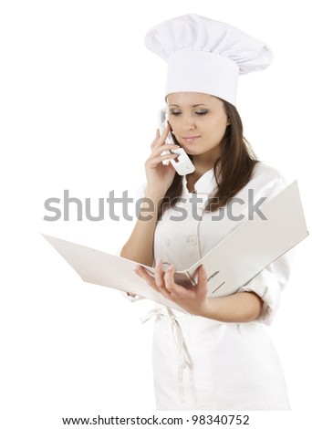 female cook with binder speaking on the phone, white background - stock photo