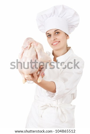 female cook with raw chicken, white backgrond - stock photo