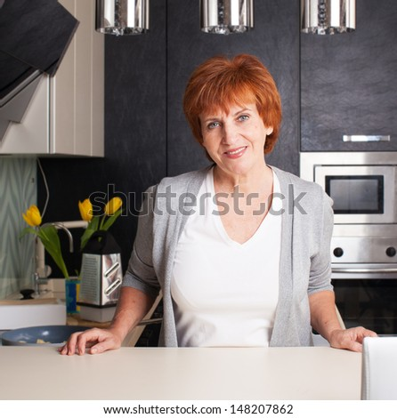 Female cooking at kitchen. Woman at home