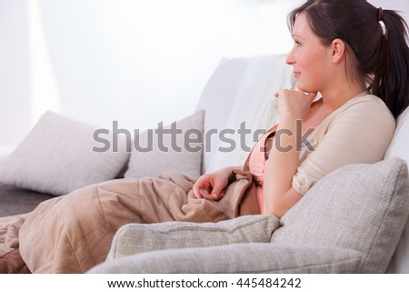 female couch relaxing wathcing tv - stock photo