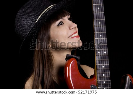 Female country singer holding a red guitar