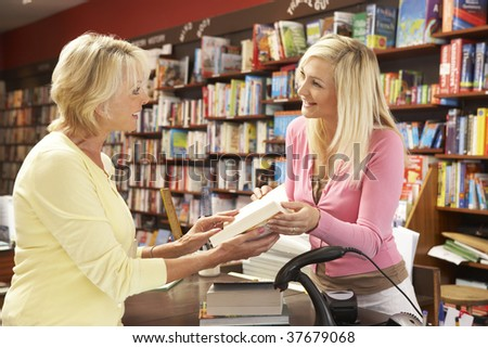 Female customer in bookshop - stock photo