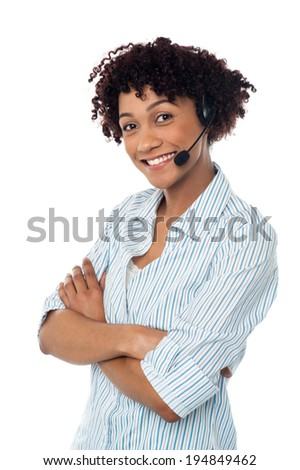 Female customer service agent posing with arms crossed - stock photo