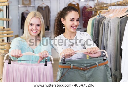 Female customers shopping skirt and trousers at the store