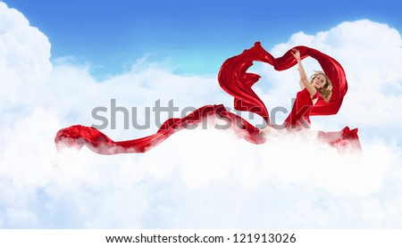 Female dancer and red heart symbol from fabrique - stock photo