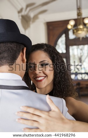 Female Dancer Looking At Man While Performing Tango
