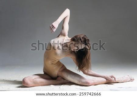 female dancer posing in studio - stock photo