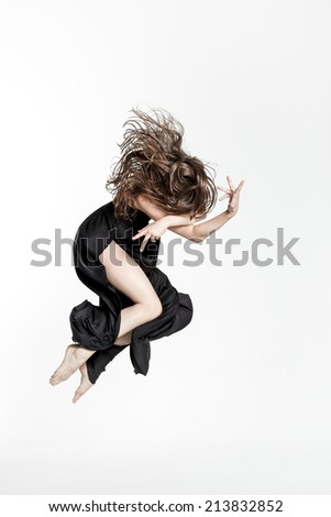 female dancer posing on studio background - stock photo