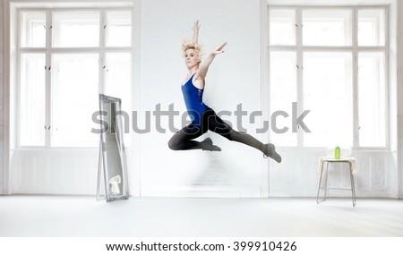 Female dancer practicing in studio. Motion blur. - stock photo