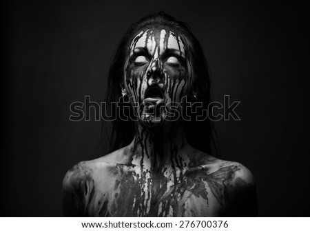 female demon.Art studio shot.Goth girl with sliced tongue - stock photo