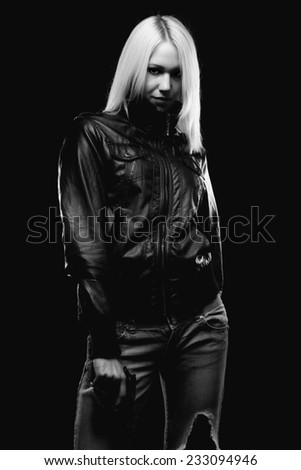 Female detective holding gun isolated on black background. - stock photo
