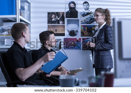 Female detective is talking about crime investigation - stock photo