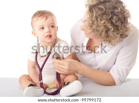 Female doctor and baby patient - stock photo