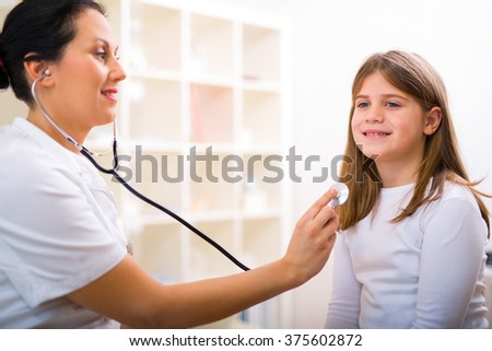 Female doctor and little girl patient. Medical examination - stock photo